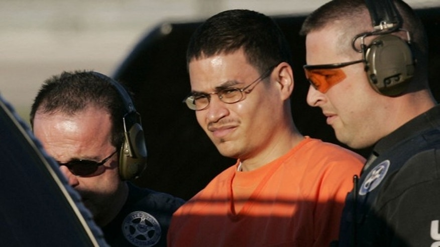 Jan. 5, 2006: Jose Padilla, center, is escorted to a waiting police vehicle by federal marshals near downtown Miami.