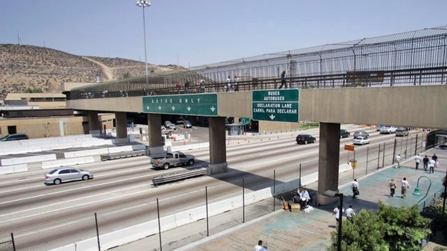 Pedestrians cross over Interstate 5 at the San Ysidro Border Crossing while others traveling into Mexico head under the bridge, July 23, 2007 in San Diego.
