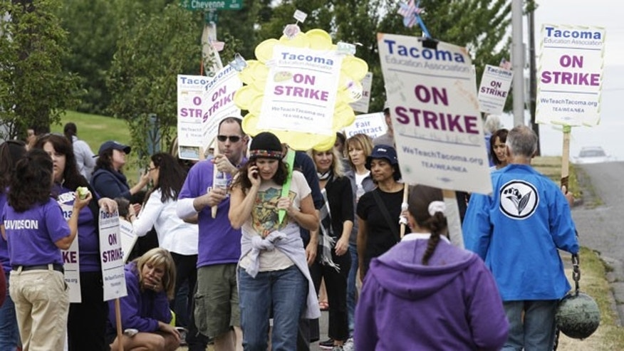 September 21: Striking Tacoma public school teachers walk a picket line outside Foss High School in Tacoma, Wash.