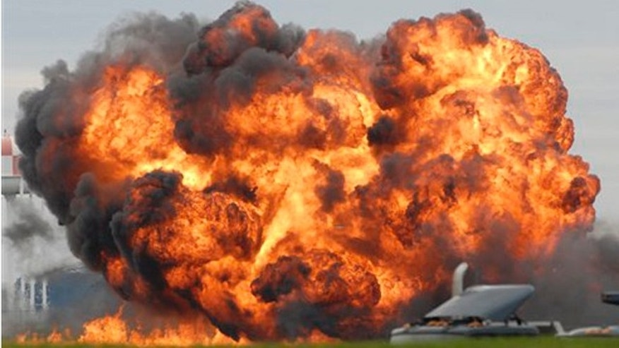Sept. 17, 2011:A fireball is seen after a single engine T-28 from the six-plane Trojan Horsemen Demonstration Flight Team crashes and explodes during a performance at the Thunder Over the Blue Ridge Open House and Air Show at the 167th Airlift Wing in Martinsburg, W.Va.