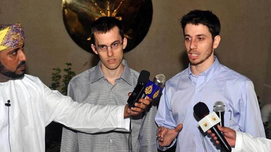 Freed American Shane Bauer, center, and Josh Fattal, right, talk to the media upon their arrival from Iran, in Muscat, Oman Wednesday, Sept. 21, 2011.