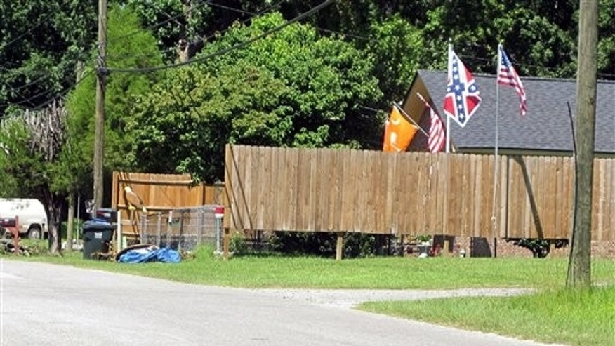 In this Sept. 8, 2011, photo, the Confederate flag is displayed on a pole outside Annie Chambers Caddel's home in Summerville, S.C.