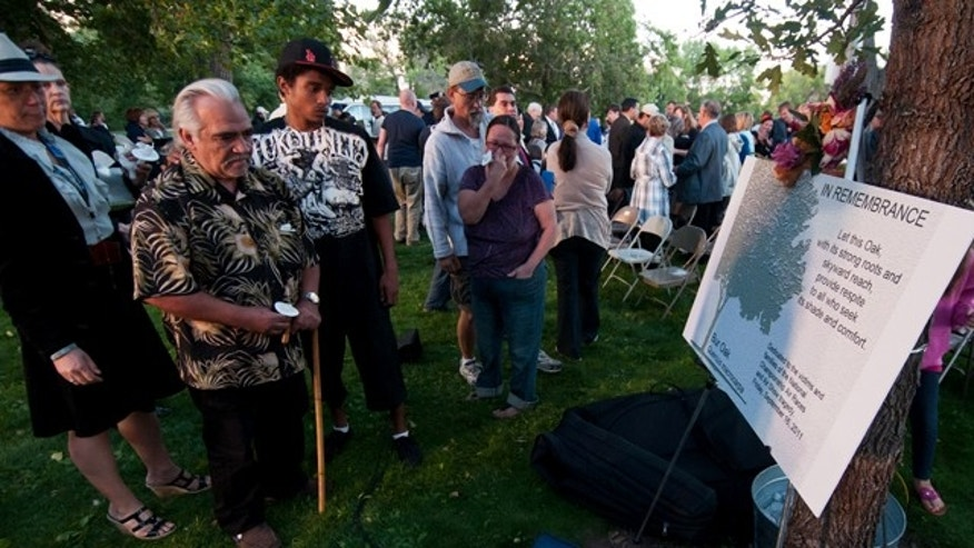 Sept. 25: Jose Luis Joe Cacheux-Ojeda, 59, looks at the memorial tree with loved ones during the memorial service for the victims of the Sept. 16 National Championship Air Races crash in Reno, Nev.