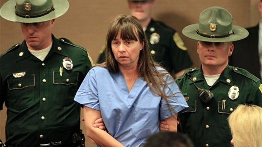 In this May 19, 2011 file photo, Julianne McCrery, 42, of Irving, Texas, arrives in District Court in Portsmouth, N.H.  Court officials say McCrery, accused of killing her 6-year-old son in New Hampshire and disposing of his body in rural Maine will plead guilty.