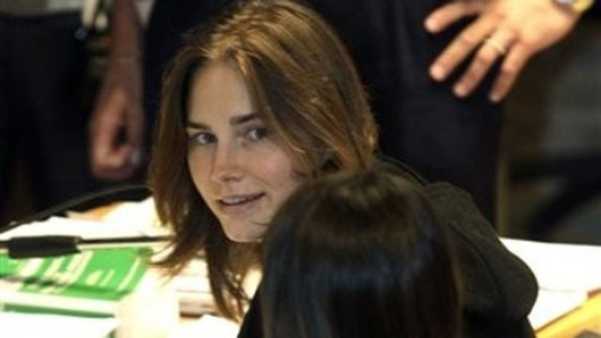 September 29: Amanda Knox looks on as she sits next to her lawyer Maria Del Grosso at the Perugia court, central Italy.