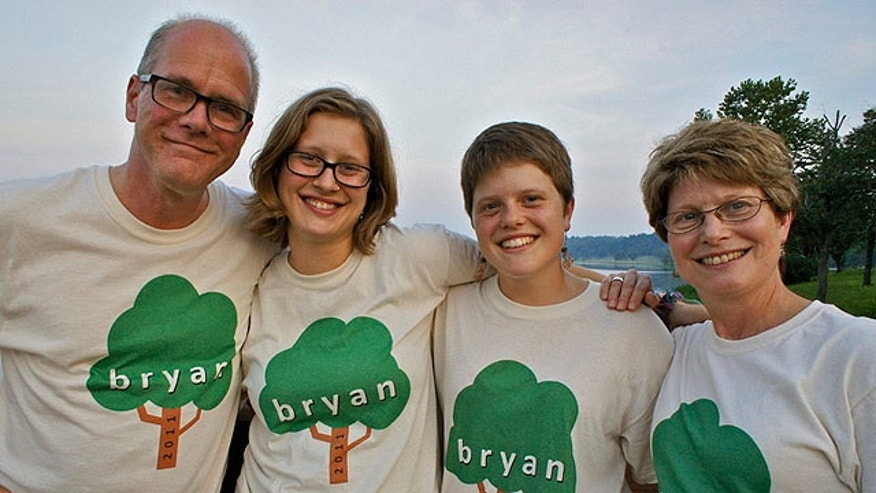 This undated family handout photo shows missing bicyclist Mark Bosworth, left, with his wife Julie, right, daughters Claire, middle right, and Kelly at a family reunion.