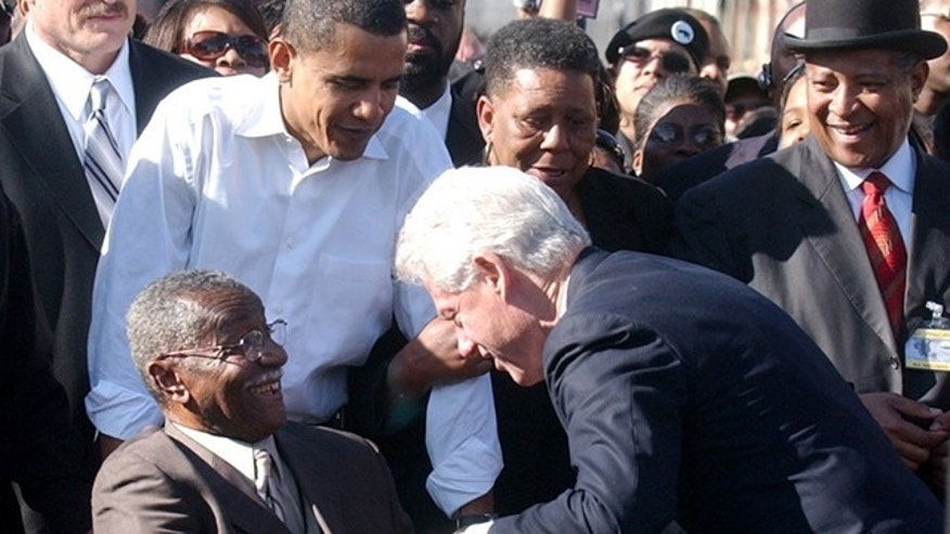 FILE 2007: Then-Senator Barack Obama, second from left, looks on as civil rights leader Fred Shuttlesworth, front left, greets former President Bill Clinton in Selma, Ala.