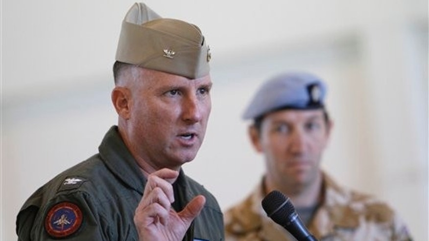 October 6: Captain Devon Jones, Commanding Officer of Naval Air Station El Centro, talks about exercise Crimson Eagle that will be conducted for the British Military as British officer Lt Col Peter Bullen looks on during a news conference in a hangar at the Naval Air Facility El Centro, California.