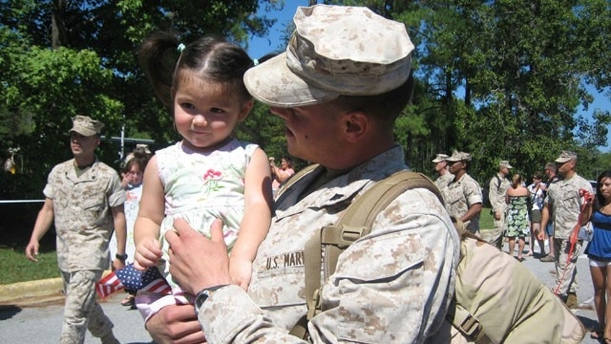 In the photo provided by the office of Rep. Chris Smith, Sgt. Micheal Elias shares a tender moment with his daughter Jade.