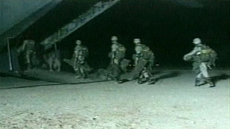"This file image from video released by the U.S. Defense Department and made available Oct. 20, 2001, shows U.S. special forces boarding an unidentified aircraft at an unknown location, the day Joint Chiefs of Staff Chairman, Gen. Richard Myers, announced at the Pentagon that U.S. special forces ""attacked and destroyed targets"" in Afghanistan. The Central Intelligence Agency together with U.S. special operations were the first Americans into Afghanistan after the attacks of Sept. 11th, and will likely be the last U.S. forces to leave."