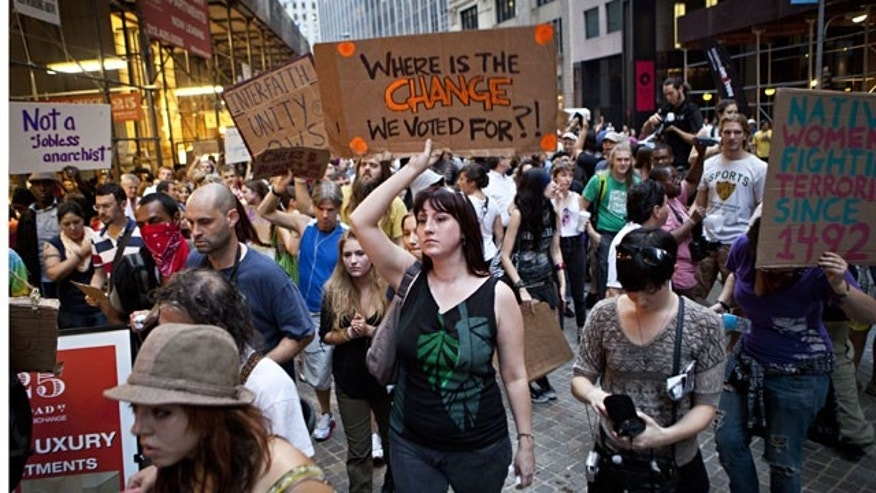 "October 10: Protesters affiliated with the ""Occupy Wall Street"" protests march through the Financial District in New York."
