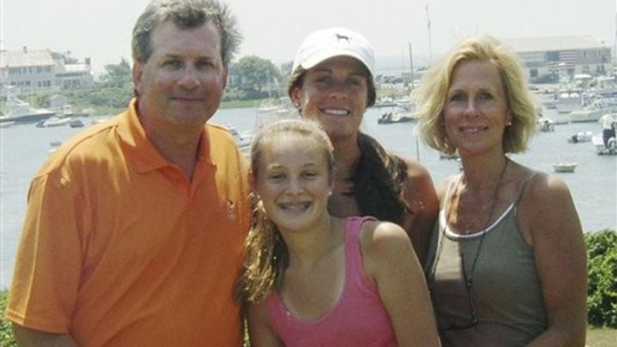 This June 2007 photo provided by Dr. William Petit Jr. , shows Dr. Petit, left, with his daughters Michaela, front, Hayley, center rear, and his wife, Jennifer Hawke-Petit, on Cape Cod, Mass. (AP)