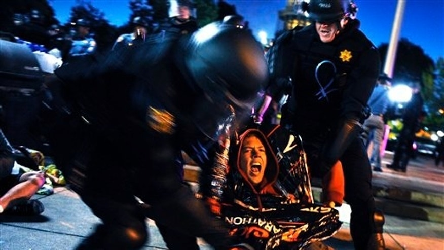 October 14: Colorado State Patrol officers drag a Occupy Denver protester away as the group is evicted early Friday morning from Lincoln Park in Denver.