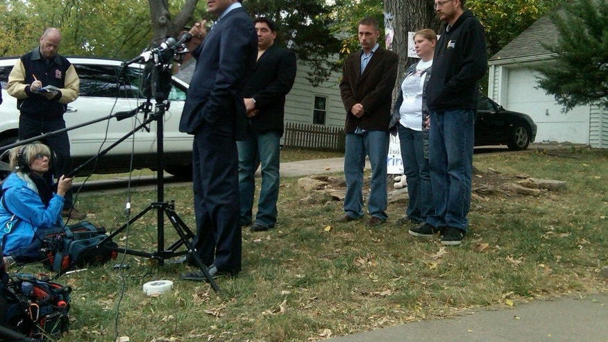 Oct. 17, 2011: Attorney Joe Tacopina speaks to reporters after agreeing to represent missing 10-month-old Lisa Irwin's family, standing at right.