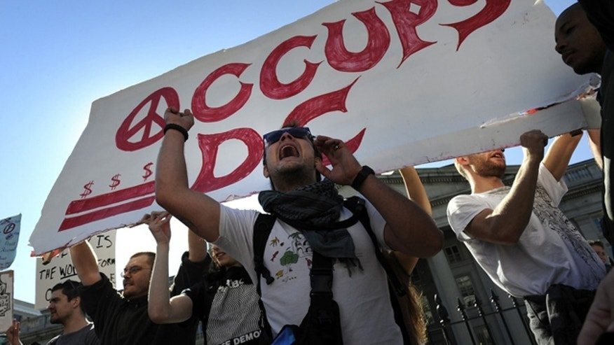 Oct. 15, 2011: 'Occupy D.C.' protesters rally in front of the U.S. Treasury Department in Washington.