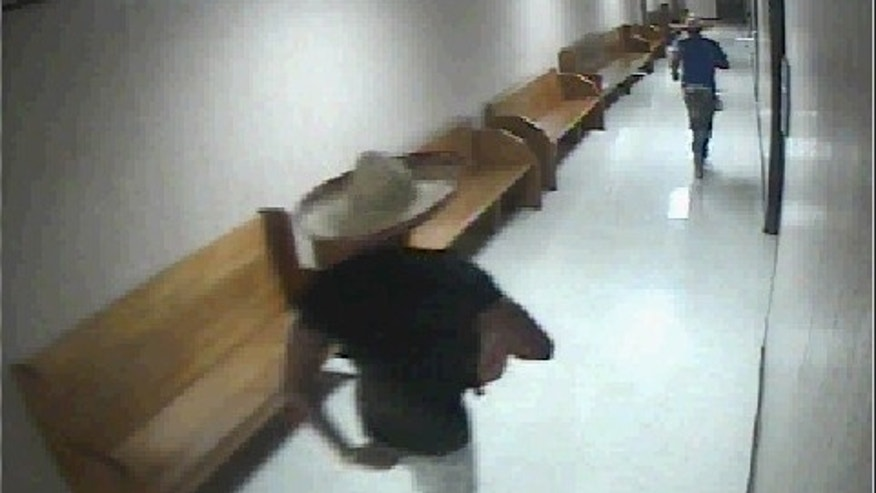 This surveillance image, provided by the Bexar County Sheriff's Office, shows two of the suspects inside the Bexar County Courthouse in San Antonio.