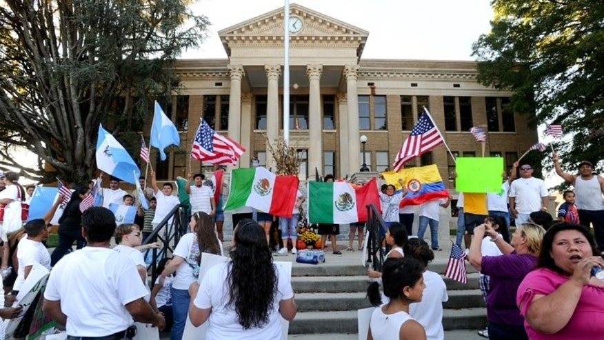 Oct. 16, 2011: Marchers gather on the steps of the Limestone County Courthouse to protest Alabama's immigration law in Athens, Ala.
