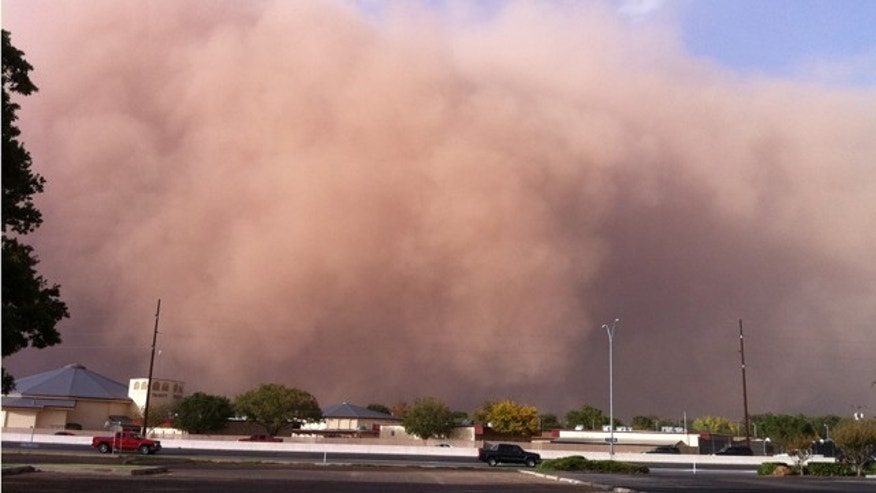 Oct. 17, 2011: This photo provided by John Holsenbeck shows a billowing wall of red dust approaching Lubbock, Texas.