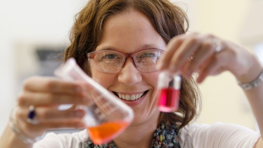 Sept. 15, 2011: William & Mary professor Elizabeth Harbron displays vials with merocyanine and rhodamine dye in her lab in Williamsburg, Va.