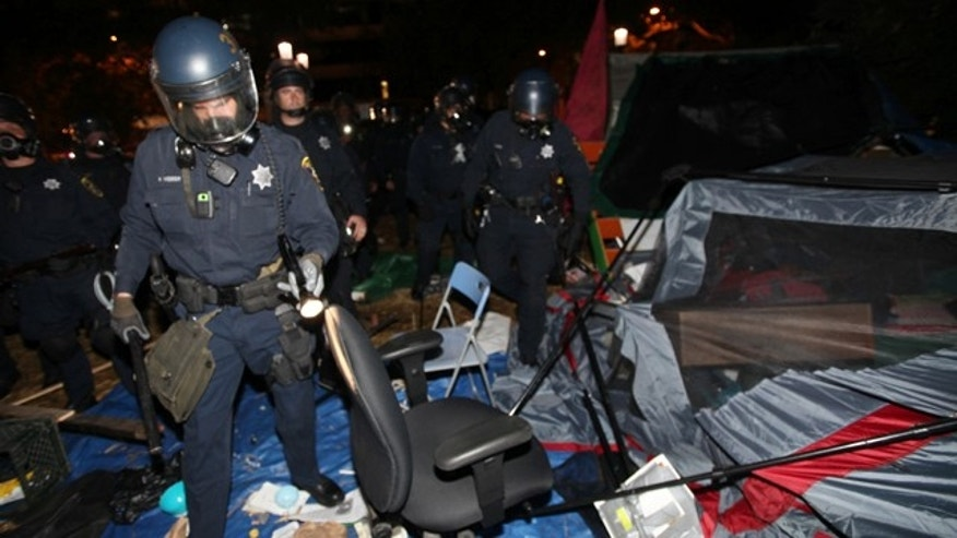 Oct. 25, 2011: Oakland police search tents and remove debris in Frank Ogawa Plaza as they disperse Occupy Oakland protesters in Oakland, Calif.