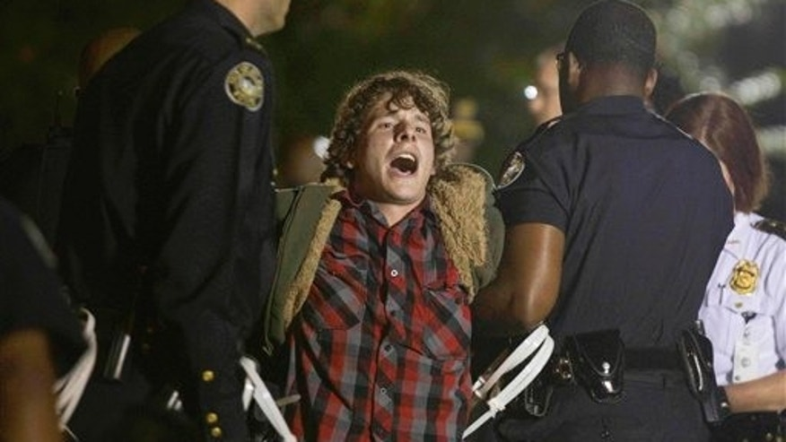 October 26, 2011: A protestor of the Occupy Atlanta demonstration is arrested after refusing to leave their camp after Mayor Kasim Reed revoked his executive order allowing the protestors to camp out in Woodruff Park.