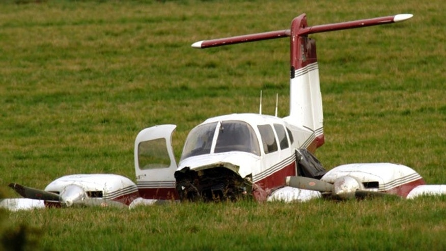 Oct. 26, 2011: A Beechcraft V35 plane sits in the field where it made an emergency landing late Tuesday after colliding with another plane in Wilsonville, Ore.