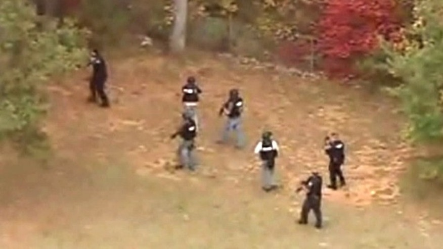 Oct. 28, 2011: Police in Greenville, S.C., hunt for a gunman who opened fire on an officer.
