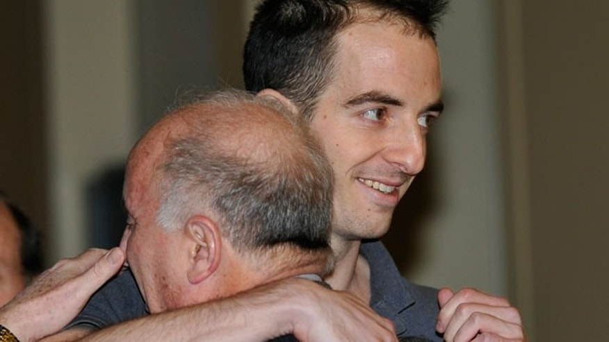 Oct. 29, 2011: Emory University law student Ilan Grapel hugs his father, Daniel Grapel as he arrives home from Israel to Kennedy Airport.