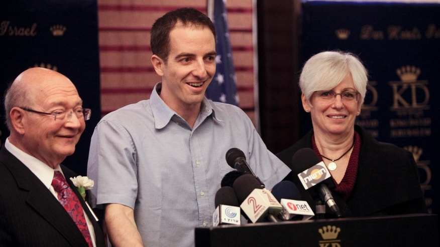 Oct. 27, 2011: U.S.-Israeli citizen Ilan Grapel, center, talks during a press conference as his mother Irene, right, and U.S. Rep. Gary Ackerman (D-N.Y.), left, stand by his side, in Jerusalem.