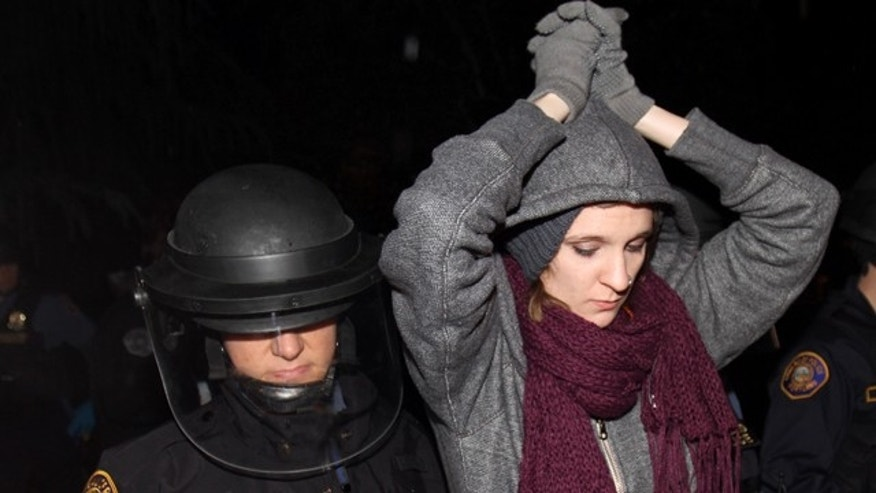 Oct. 30, 2011: A protester is forcibly removed from Jamison Park in Portland, Ore.