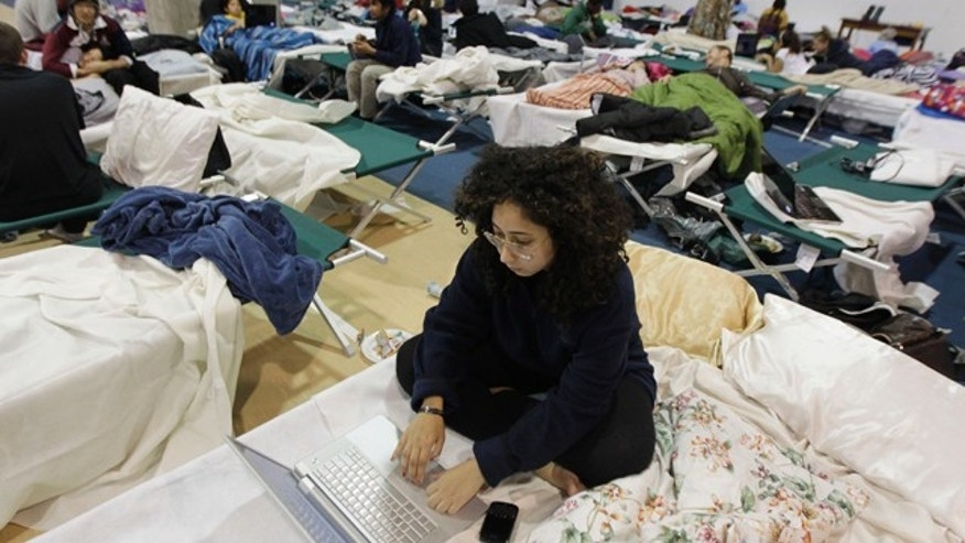 Oct. 31, 2011: Jasmine Sarryeh, an international student at Fairleigh Dickinson University, browses the internet while staying in a shelter at the school's gym following a rare October snowstorm.