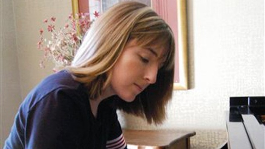 In this March 17, 2005, photo Hillary Adams, the daughter of Aransas County Court-at-Law Judge William Adams, practices the piano at her home in Rockport, Texas