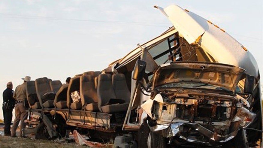 November 4, 2011: Investigators examine a bus after the crash Paint Rock, Texas.