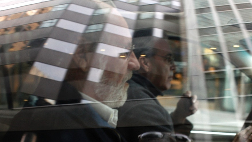 Jon Corzine, MF Global Holdings Ltd. CEO, leaves the office complex where MF Global Holdings Ltd have an office on 52nd Street in midtown Manhattan, October 31, 2011. MF Global Holdings Ltd filed for bankruptcy protection after a tentative deal with a buyer fell apart, marking a stunning failure for Corzine who tried to turn the more than 200-year-old futures brokerage into a mini-Goldman Sachs. REUTERS/Brendan McDermid (UNITED STATES - Tags: BUSINESS)