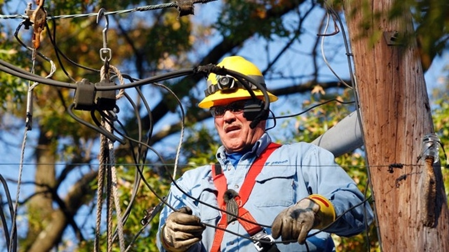 Nov. 2: Potomac Electric Power Company worker Mike Fitzgerald works to restore power to homes left in the dark since last Saturday's storm in Teaneck, N.J.