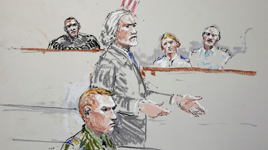 Oct. 31: U.S. Army Staff Sgt. Calvin Gibbs, seated at lower left, is shown in this courtroom sketch as his attorney Phil Stackhouse stands at center.