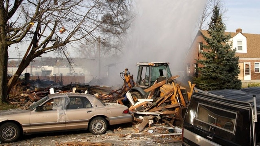 November 12, 2011: Firefighters pour water on a house explosion on Wayne Drive in Fairborn, Ohio. An official says a house exploded in western Ohio, leaving five people injured and one missing. At least three of the injured are children.
