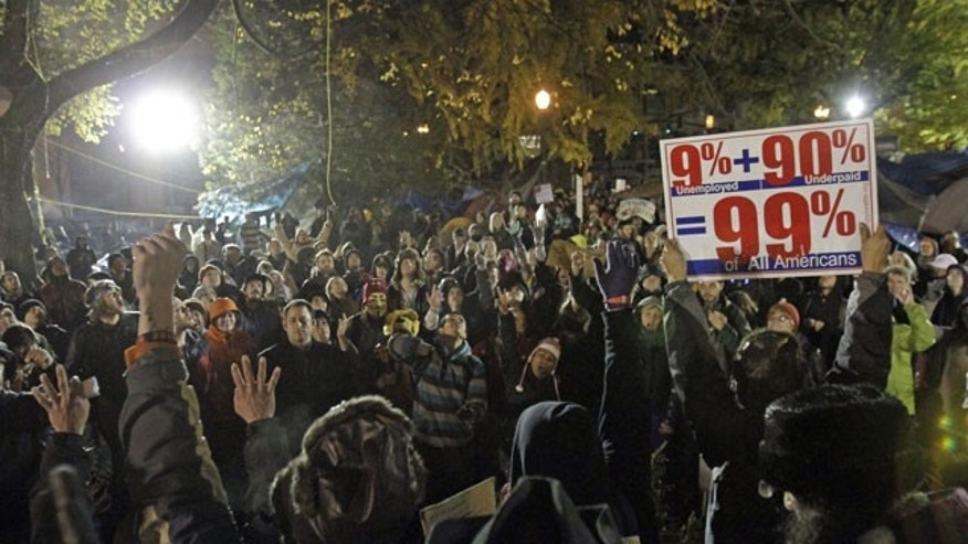 November 12, 2011: Hundreds of protesters and supporters gather hours before a mandate from the city to vacate the Occupy Portland Camp in Portland, Ore.
