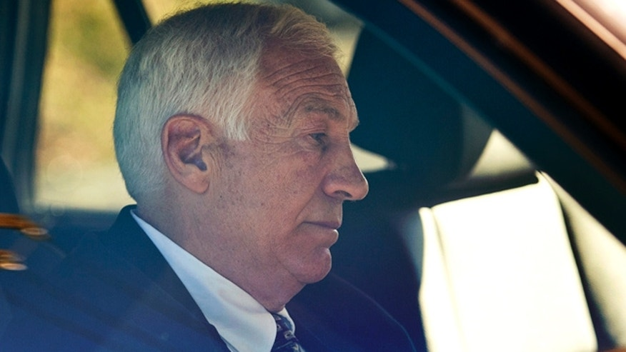 Nov. 5: Former Penn State football defensive coordinator Gerald Sandusky sits in a car as he leaves the office of Centre County Magisterial District Judge Leslie A. Dutchcot in State College, Pa.