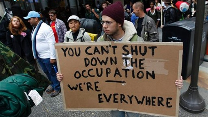 Nov. 15: John Aldous of Dallas makes his way along with others protesters through Philadelphia on a march form the Occupy Wall Street encampment in Zuccotti Park in New York to Washington.