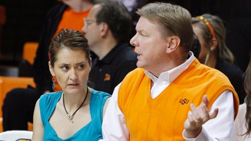 November 9, 2011: Oklahoma State women's basketball coach Kurt Budke and assistant coach Miranda Serna talk during an an exhibition women's NCAA college basketball game against Fort Hays State, in Stillwater, Okla.