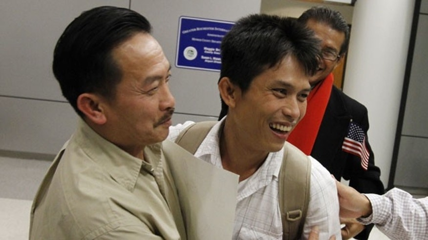 November 21, 2011: Hao Truong, Henrietta, left, embraces his son, Samart Khumkhaw, 34, during his emotion filled arrival at the Greater Rochester International Airport in Chili, N.Y.