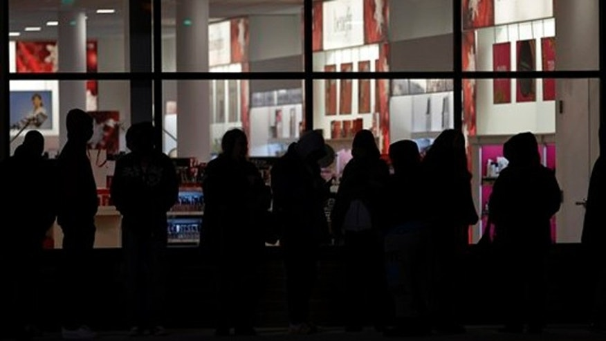 November 24, 2011: Early bird shoppers wait in a long line to get into the midnight opening of an Old Navy store in Mayfield Hts., Ohio.