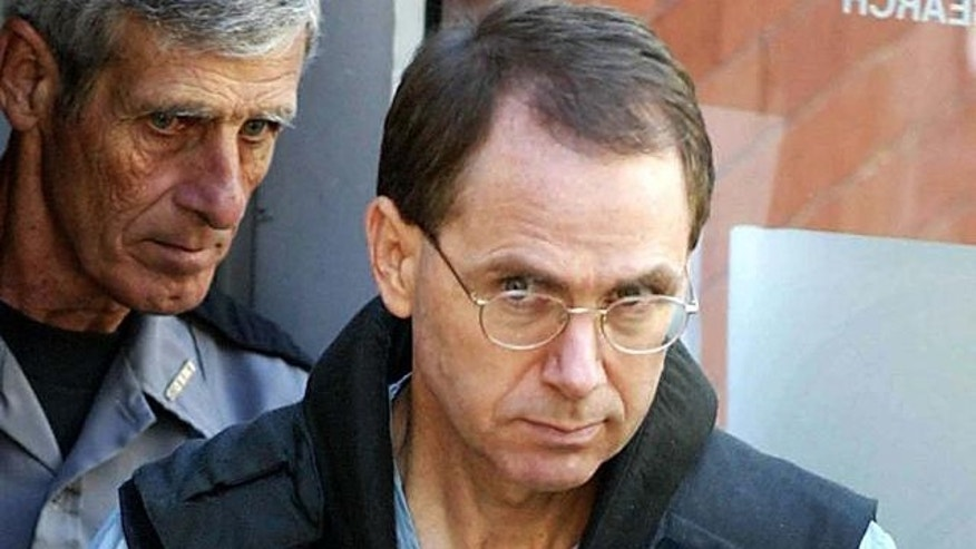 ** FILE **  Convicted Oklahoma City bombing conspirator Terry Nichols is led from the Pittsburg County Courthouse in McAlester, Okla., on Aug. 9, 2004 after his sentencing in the state's murder case against him. Pursuing information they missed evidence a decade ago, FBI agents searched the former home of convicted Oklahoma City bombing conspirator Terry Nichols and found blasting caps and other explosive materials apparently related to the 1995 attack, officials said Friday, April 1, 2005. (AP Photo/Donna McWilliam)