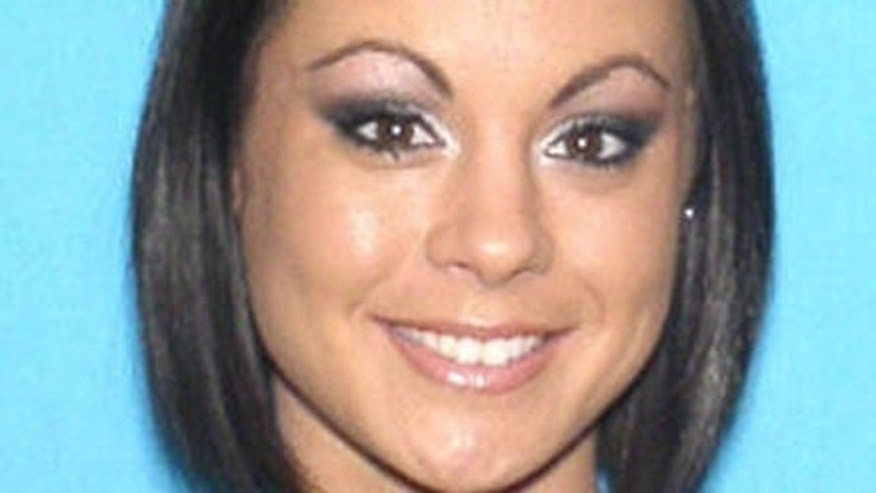 FILE- This photo shows Michelle Parker, of Orlando, Fla., who disappeared on the same day an episode of  'The People's Court' TV show aired featuring her and her ex-fiance.