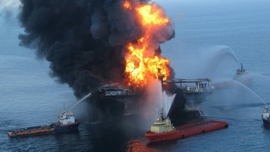 FILE 2010: Fire boat response crews battle the blazing remnants of the offshore oil rig Deepwater Horizon off Louisiana.