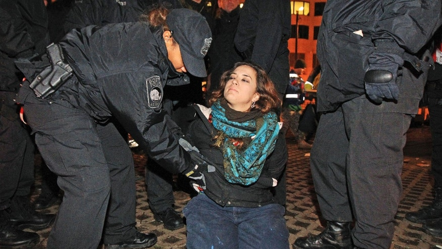 Dec. 10, 2011: Boston police officers remove an Occupy Boston protester from Dewey Square in Boston before dawn Saturday.