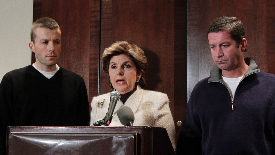 Attorney Gloria Allred with clients Bobby Davis and Michael Lang at a press conferance in Midtown Manhattan to announce the filing of a defamation lawsuit against Syracuse Basketball coach Jim Boeheim after he made negative comments about their accusations against assistant coach Bernie Fine.
