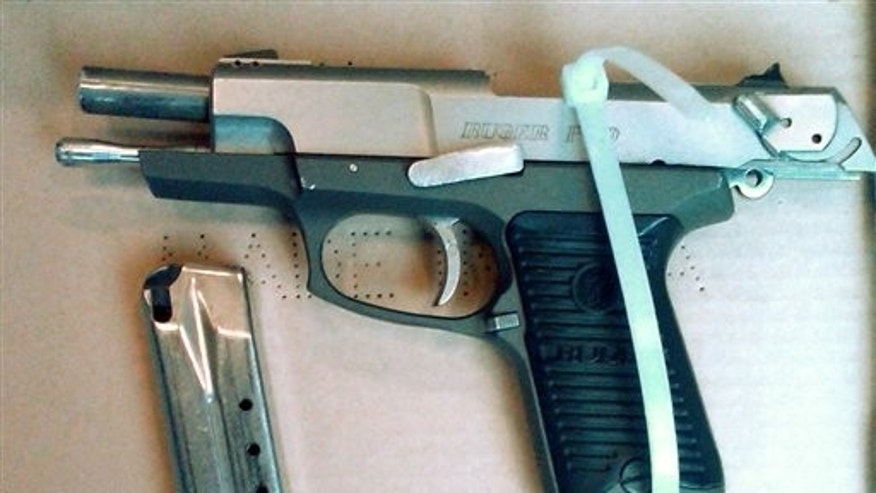 This photo provided by the New York City Police Dept. shows a semi-automatic pistol recovered by police after Officer Peter Figoski was shot in the face and killed early Monday morning, Dec. 12, 2011, while responding to a report of a break-in at a Brooklyn apartment.