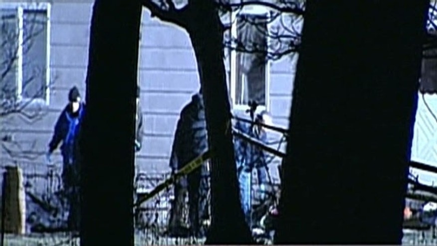 Dec. 17, 2011: Police investigate a crime scene in Illinois where five people were found shot to death.